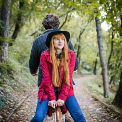 Couple enjoying ride on bicycle