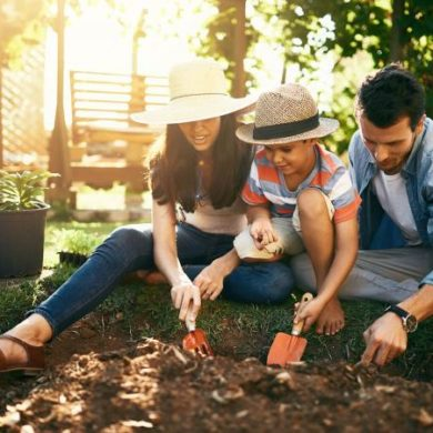 family gardening together in their backyard