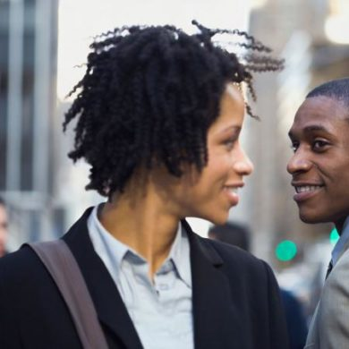 businesswoman making eye contact with man