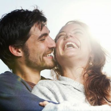 Young couple hugging and laughing together
