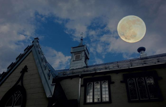 full moon over building