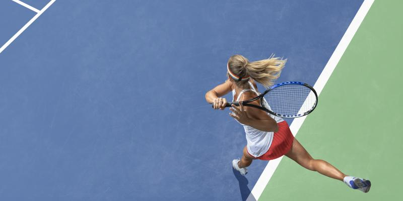 competitive woman playing tennis