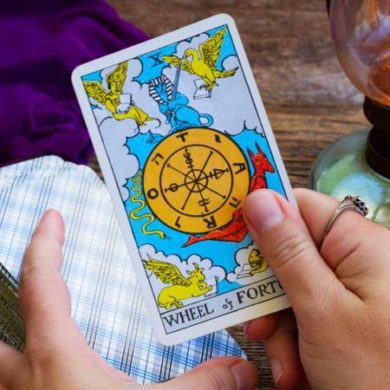 Holding wheel of fortune tarot card