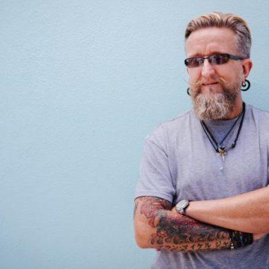 Portrait of stylish mature man with beard and tattoo