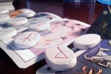 Tarot cards and runes used for a reading