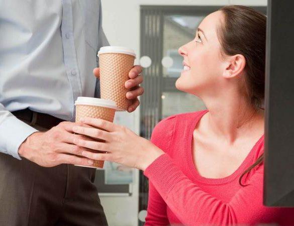 Male bringing female coffee