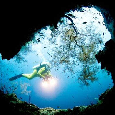 Deep sea diver in a cave