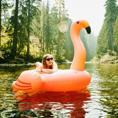 laughing woman floating down river