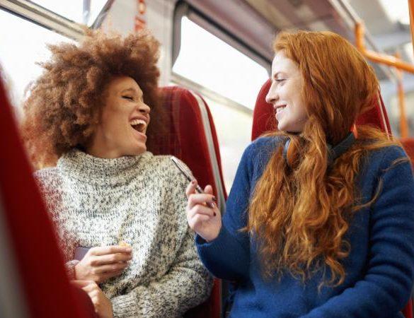 Two women talking on a train