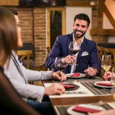 Handsome man looking seductively at a woman in restaurant